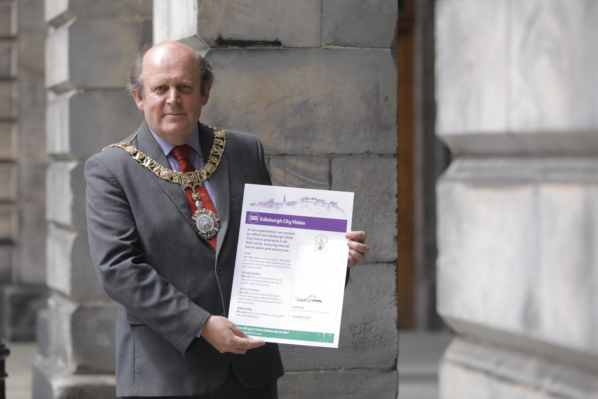 Landscape lord provost with city vision charter outside city chambers credit city of edinburgh council