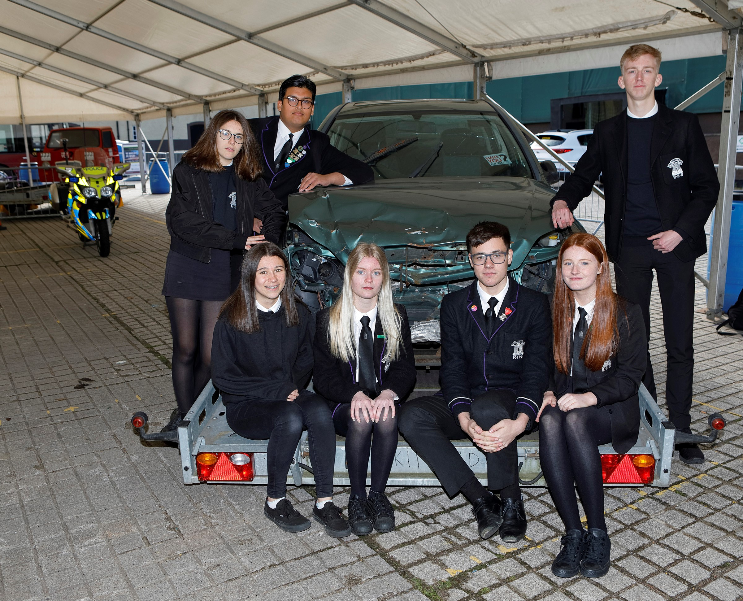 Royal High pupils see a car damaged by a crash to learn about the impact of irresponsible driving.