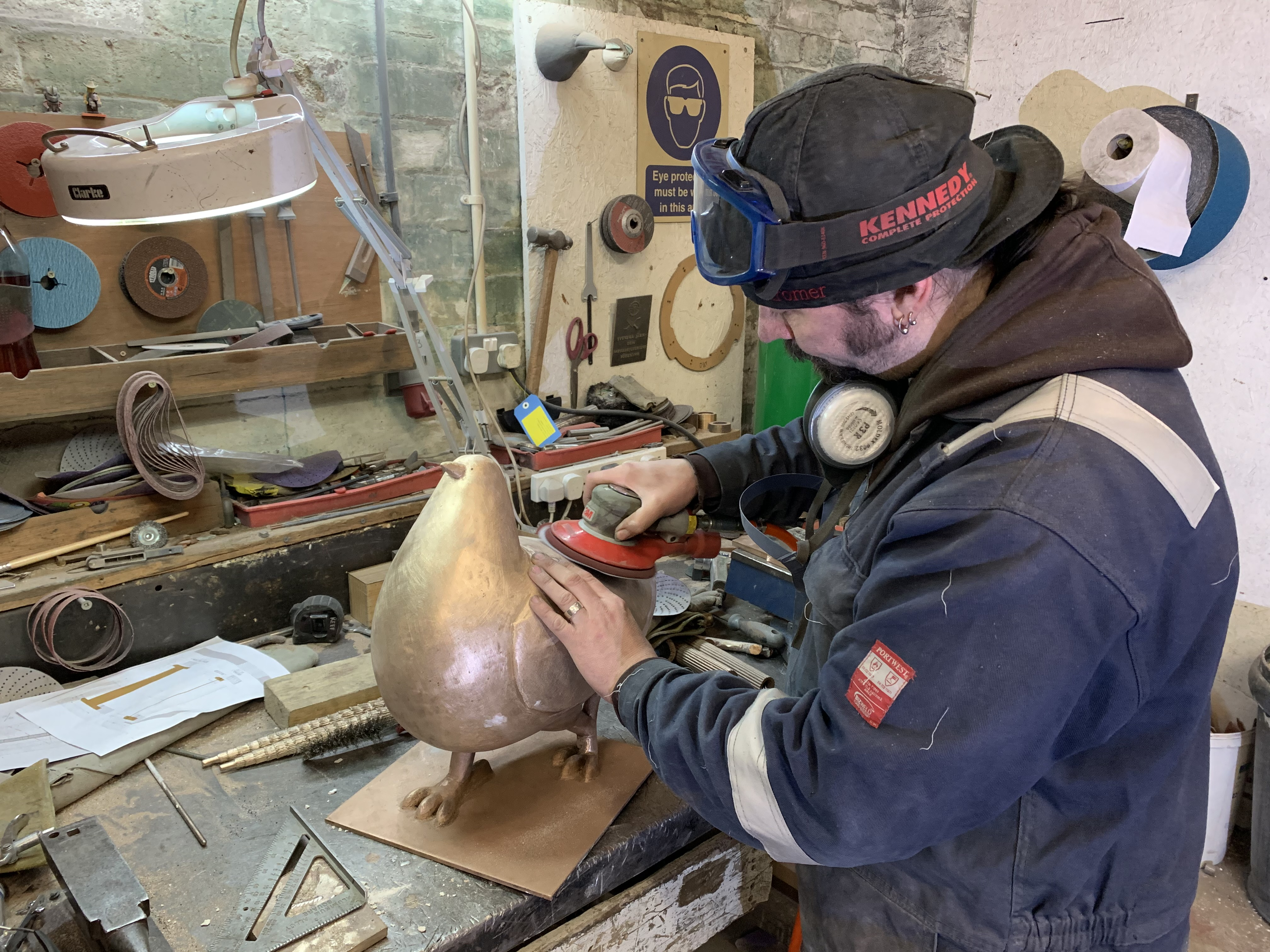 Elm Row pigeons being recast by Powderhall Bronze employee.